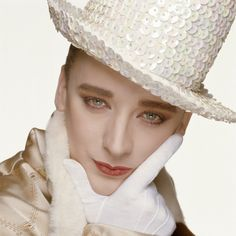 English pop star Boy George in a sequinned hat, circa Boy George, George Hats, Culture Club, Pop Culture, Terry O Neill, Diamond Dogs, Celebrity Portraits, Color Photography, Beautiful Boys