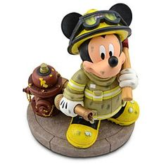 Disney Fireman Mickey Mouse Figure -- 9 1/2'' H | Disney StoreFireman Mickey Mouse Figure -- 9 1/2'' H - Your home will be both safer and cuter with Fireman Mickey around. Created by Disney artist Richard Szrnech, this figure shows the pride of the Main Street firehouse with his pick and hose, all ready to provide some emergency smiles whenever you call.