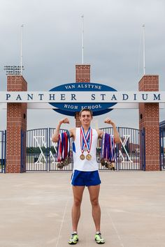 Senior Boy Athlete with medals, cross country, track and field.  Senior Picture