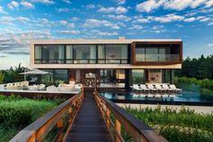 Casa de praia modernista parece flutuar sobre o mar