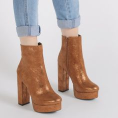 We're doing a serious nod to the 80's with the newest addition to our platform family. Isha will have our pdbaes up in the clouds! With statement block heel this metallic platform ankle boot will have heads turning. Style with skinny jeans and an oversized tee.  Heel Height: 5\
