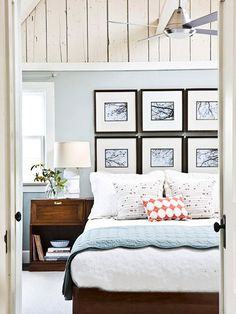 blue and brown room, black and white grid photographs behind bed