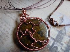 This unique handcrafted tree of life is wrapped with copper wire around a beautiful semi precious stone. Intricate swirls of cooper hold the circle of life together. This copper tree of life pendant is hung on a combination of brown and champagne colored tiger tail wires and an antique copper lobster claw clasp giving it a natural look.