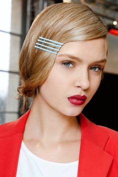 Even baby blue barrettes stand out with serious red lips (seen at Cacharel)