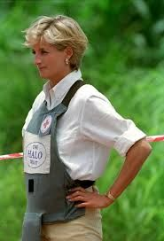 January 15, 1997: Diana, Princess of Wales tours a minefield dressed in a flak jacket and face shield in Huambo, central Angola. The Princess was visiting Angola for the Red Cross, to see for herself the carnage mines can cause..