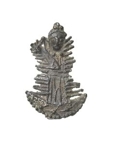 Pilgrim badge Pilgrim badge depicting the Assumption of the Virgin Mary to Heaven. Mary is shown standing on a crescent moon and is surrounded by an irregular aureole (field of glory). It is possible that this badge was made at the shrine of Our Lady of Walsingham in Norfolk for the feast of the Assumption on 15 August, one of the major festivals of the Virgin Mary. Production Date: Late Medieval; 15th century