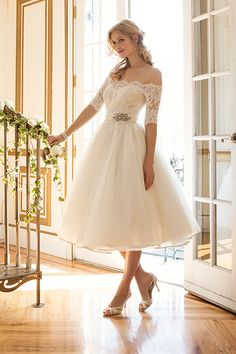 Retro-inspired gowns are all the rage right now. Kick up your heels in a charming tea-length style with a full skirt and fitted sleeves by Justin Alexander.