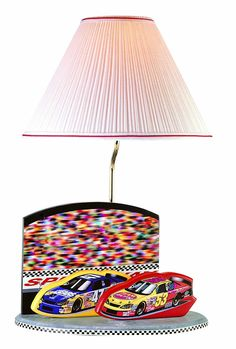 This table lamp by Lite Source Inc. features NASCAR accents, a pleated shade and wood and metal construction. Room Lights, Ceiling Lights, Nascar Heat, Race Car Themes, Grey Table Lamps, Room Lamp, Nascar Racing, Nursery Inspiration, Joss And Main