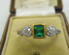 Top quality all platinum emerald and diamond trilogy art deco ring