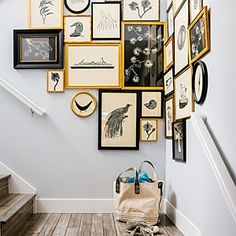 A corner gallery wall - black, white & gold, and frames so close they're touching. Art by Jennifer Ament. | Sunset Idea House - 2013 (Seabrook, Washington)