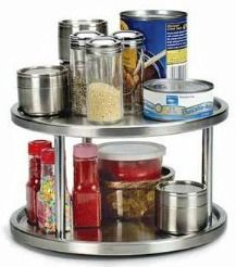 Increase storage space, and make it easier to get to hard to reach in the back items in your pantry with a lazy susan {featured on Home Storage Solutions 101}