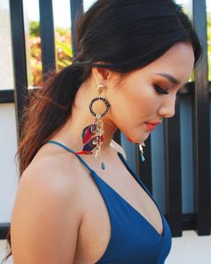 Freya earrings in multicolour. Paired this beautiful feather earrings with our Avara bodycon. Available now at Amari K Boutique.