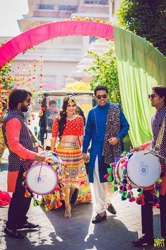 A bright and colourful mehendi function with bride and groom entering with dhol Mehndi Function Dresses, Designer Lehnga Choli, Bridal Chuda, Mehndi Outfit, Bridal Lehenga Collection, Indian Skirt, Haldi Ceremony, Indian Gowns Dresses, Indian Wedding Planning
