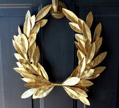 The Laurel Crest Wreath design has captivated our attention with its distinction for centuries.  This MINI classic wreath combines faux golden laurel bay leaves with the rich traditional meaning of peace and victory.  Our Crest Wreath design is a standout addition to any decor.  Enjoy it as a centerpiece, above a sideboard/bar cart, over a fireplace, on a mirror or in an entryway to greet guests year round.   Recommended for indoor use. Molded Plastic Faux Leaves with metal rod support…