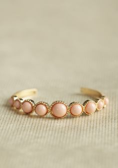 Strawberry Glow Cuff Bracelet 14.99 at shopruche.com. Glossy strawberry pink stones adorn this simple and chic gold-toned cuff bracelet.2.5