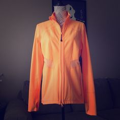 New Zella Orange Workout Jacket Brand new highlighter orange workout jacket by Zella. Great color for visibility in low light. Breathable mesh panels on front and back. Thumb holes in the sleeves for extra warmth. There are some small black spots on the back that were there when purchased. Priced accordingly. Zella Jackets & Coats