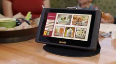 24. So recently, it appears that many Applebee's are installing these self order devices on every table.  The idea is you can browse through some of the menu to order additional food and drinks- without waiting on a server.  Then eventually pay your tab with a credit card directly on the machine.  No waiting 15 minutes for the check. - this could improve poor service felt at many stores, as you could tell the waiter or waitress when you needed new items or drinks without having to wait.