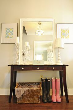 May have to copy this entry look. Have that table, similar lamp and mirror. just need the pretty candle holders and hang some pics.