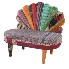 One-of-a-kind peacock settee with a mango wood frame. Upholstered with reclaimed Kantha throws.   Product: SetteeCon...