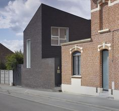 Black houses. (Talk about making a statement in the neighborhood!) // Maison D by Emmanuelle Weiss