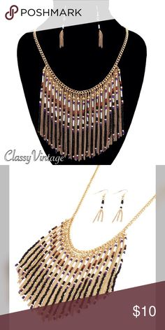Black & gold seed bead fringe necklace set Gold tone chain with black seed bead fringe with accent colors. Matching earrings included. 18 inches long and fringe length is 4 inches. Hailey Jewelry Necklaces