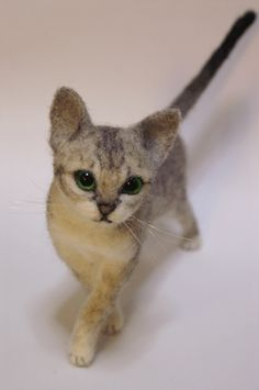 Unbelievably this is a felted cat .... by an incredible Japanese artist.  This is just one of a great many felted animals.