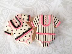 White, black and pink onesie cookies. www.thesweetesttiers.com