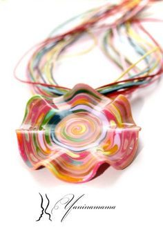 Polymer clay pendant. Love it. Don't know the artist but love it.