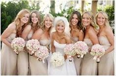 Gold/ champagne bridesmaids dresses. I kind of like the idea of gold/champagne color schemes
