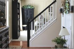 stained and white banister