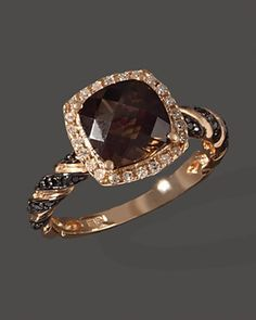 ring im getting for my birthday! diamond, black diamond and smokey quartz with set in rose gold!