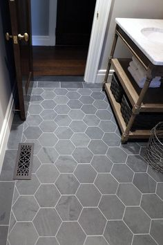 black flooring Inspiring baths -- Brazil Black 8 Hexagon Floor, at The Tilery: Your New England and Cape Cod Tile Experts Bath Tiles, Bathroom Floor Tiles, Bathroom Renos, Bathroom Interior, Small Bathroom, Entryway Tile Floor, Hexagon Tile Bathroom Floor, Black Hexagon Tile, Honeycomb Tile