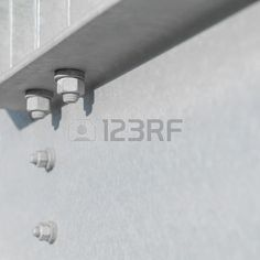 Hexagon nuts on bolts in a steel structure with space for text
