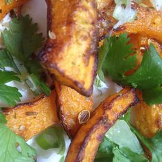 Vegetable Starch Roast Acorn Squash with Dukkah Spices and fresh Cilantro and Green Onion dressed with Lime Tahina