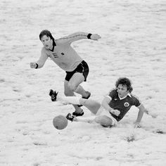 Everton striker Andy King slides in to tackle Steve Daley of Wolverhampton Wanderers during their First Division match played on a snow covered pitch at Molineux in Wolverhampton, February Wolverhampton Wanderers won (Photo by Bob Thomas/Getty Images) Football Music, School Football, Football Cards, Football Players, Wolverhampton Wanderers Fc, Andy King, Kenny Dalglish, Nostalgic Pictures, Goodison Park