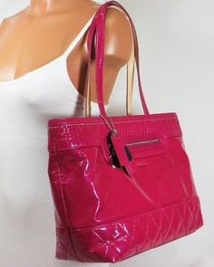 Coach Poppy Liquid Gloss Large Tote Bag Nickel & Magenta Enamel Coach Logo on the Front, Two Interior Multi-Functional Pockets - can be used for your cell phone, iPod, PDA. Click Pic for More Info