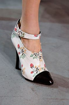 I love these.  I don't know what I would ever wear them for but they are super cute!  Derek Lam