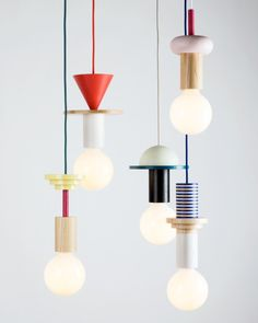 """Geometric coloured timber components stack to create quirky pendant lights. """"Modular geometric pendant lights by the northern-German design studio Schneid"""". Blitz Design, Geometric Pendant Light, Style Deco, Luminaire Design, Deco Design, Design Trends, Design Ideas, Lighting Design, Kids Lighting"""
