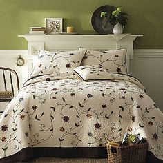 Good-looking quilt has a sophisticated multi-color chain stitch embroidery framed beautifully by a chocolate border. The rich coloring adds warmth while the vermicelli stitching brings old world charm.