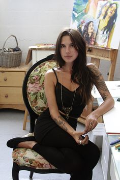 Charmaine Olivia, self-trained artist, extensive use of social media to promote her brand (often in a bikini, lol).