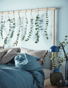 Bring nature into your bedroom this holiday. Decorate your bed frame with plants. IKEA has a lot of modern bed frames such as GJÖRA in birch. Use the low end as a headboard or the other way around. Hang flowers or fabric for a personal touch.