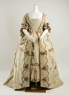 Fashion 18th century ball gown dress Robe a la Francaise circa from 1760-1780. Made from silk with flower floral bouquet pattern in various colours and fabric gather as flounce decorated with lace, trim, ribbon, on the matching stomacher bodice, sleeve and also on the skirt and the petticoat.