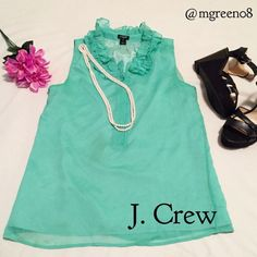 J. Crew Ruffle Sleeveless Blouse J. Crew Ruffle Sleeveless Blouse in mint. Buttons halfway down the front with ruffle detail around neck. 100% polyester with a 100% acetate lining. Machine washable! This is a beautiful piece that can be worn under blazers or cardigans or as a stand alone! J. Crew Tops Blouses