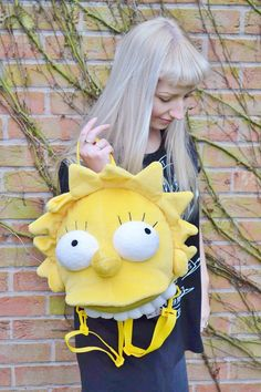 Vintage plush Lisa Simpson backpack with adjustable and removable straps. In great vintage condition with some minor signs of wear. Approx.
