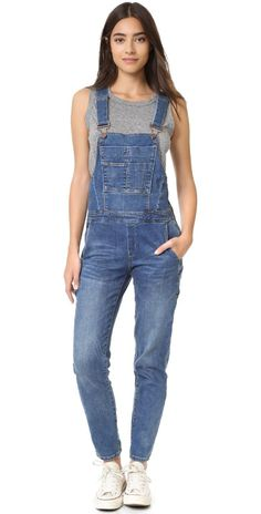 Overalls : A pair of pants with an extra piece attached that covers the chest and has straps that go over the shoulders.