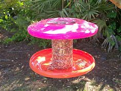 Bird feeder of recycled Frisbees and a plastic container.  How clever!