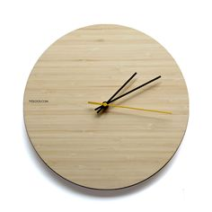 Natural Bamboo wall clock - timeless, modern design by TYDLOOS.