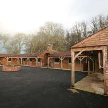 range of wooden panel stables