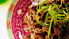 Spicy beef with tangerine (chen pi niu rou)   This dish is one of the better-known dishes from the Sichuan province. It is traditionally very spicy, but our version is medium in heat. Dish is designed to be part of a banquet.