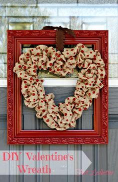 Polka dot burlap ribbon wreath hung on red frame...perfect for Valentine's day decorating!